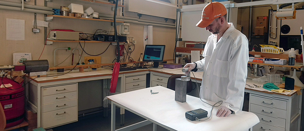 Person measuring on equipment in the Radiochemistry laboratory