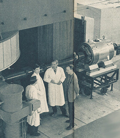 Personnel beside the cyclotron in the 1950ies